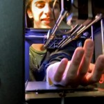 volunteer-places-his-arm-into-automated-tattooing-machine-that-has-been-modified-makerbot