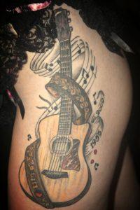 Tatuajes de guitarras - | Tatuajes Logia Barcelona
