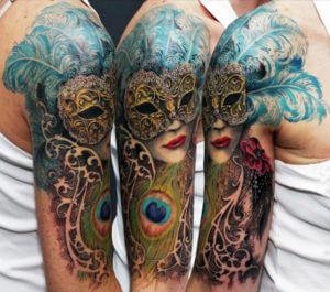 half-sleeve-mardigra-mask-and-peacock-feather-tattoo